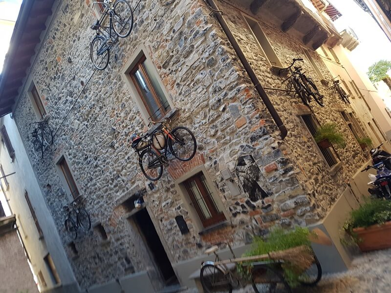 A traditional old house adorned with bikes in San Giovanni!