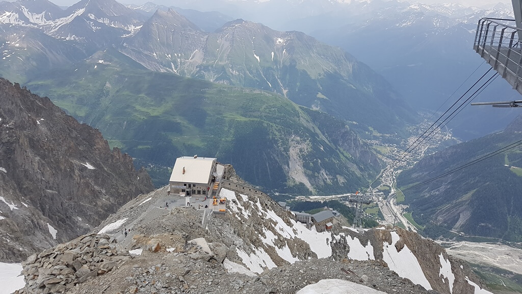 Views of the Torino Hut and then, lower down, the town of Courmayeur from Punta Helbronner in the Summer