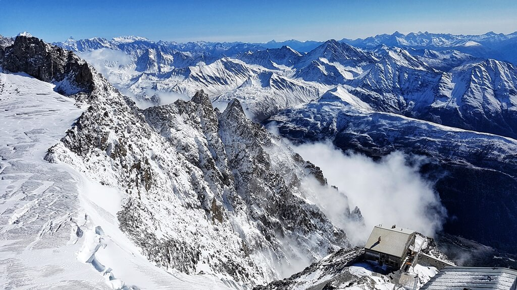 Snowy mountain views with the Torino Mountain Hut in sight from Skway Monte Bianco top station Punta Helbronner